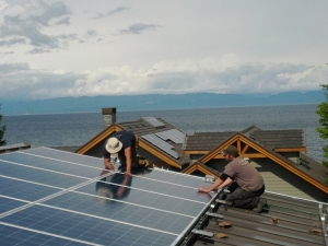 Two men installing a residential solar system.