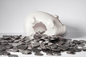 Piggybank overturned and full of change