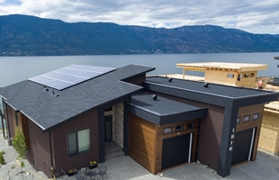 Lake Country home with solar panels on roof.