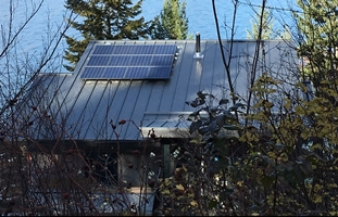 Picture of cabin with solar panels on it